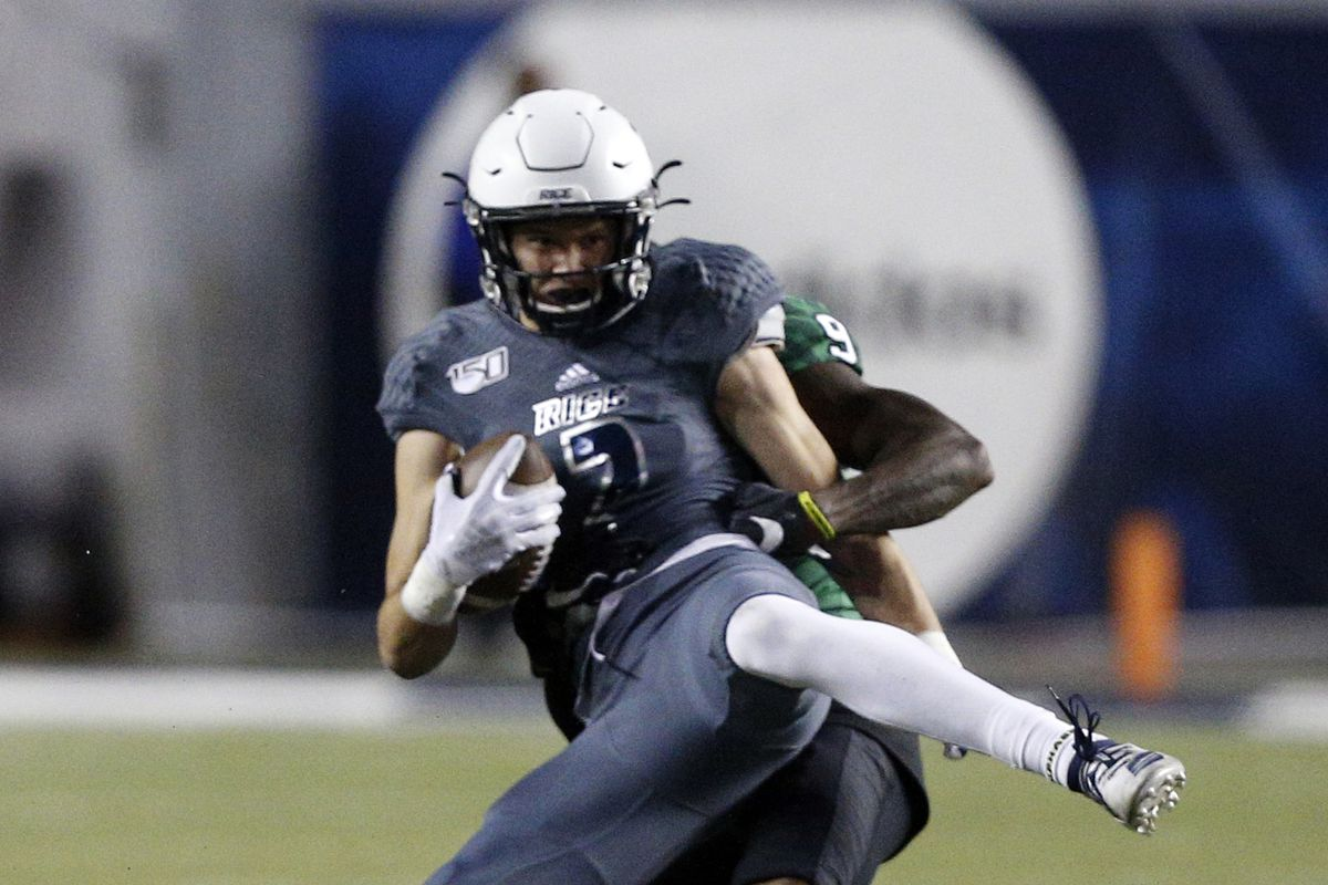Brad Rozner of the Rice Owls makes a catch in front of Nick Harvey of the North Texas Mean Green for a key first down during the fourth quarter against the North Texas Mean Green at Rice Stadium on November 23, 2019 in Houston, Texas.