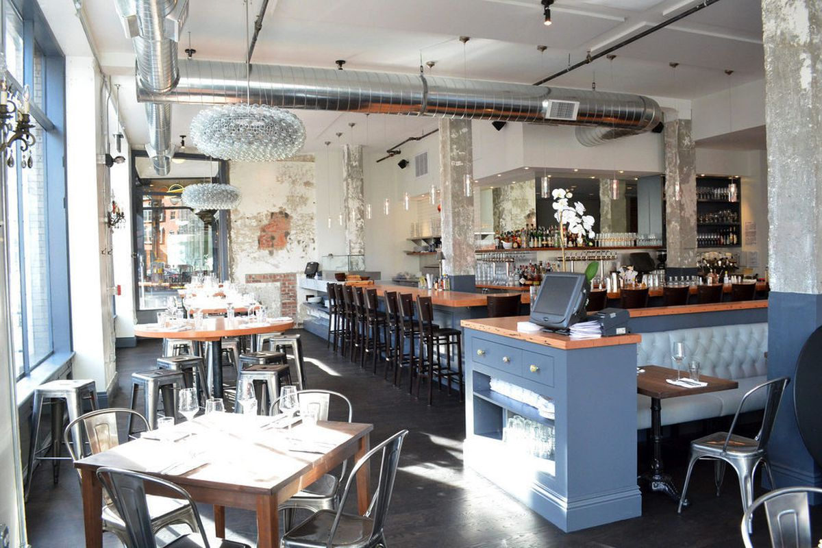 the front dining room includes a variety of seating options including high top tables and bar seating the sustainable seafood bar can be observed at the - The Kitchen Denver