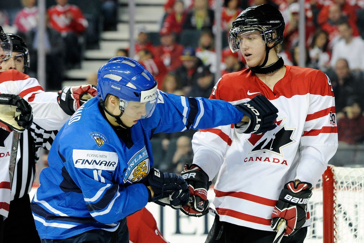 Seen here toying with Markus Granlund at the World Junior Championships last year, Dougie Hamilton is set to make the Bruins out of camp this season, but don't expect a superstar right away.