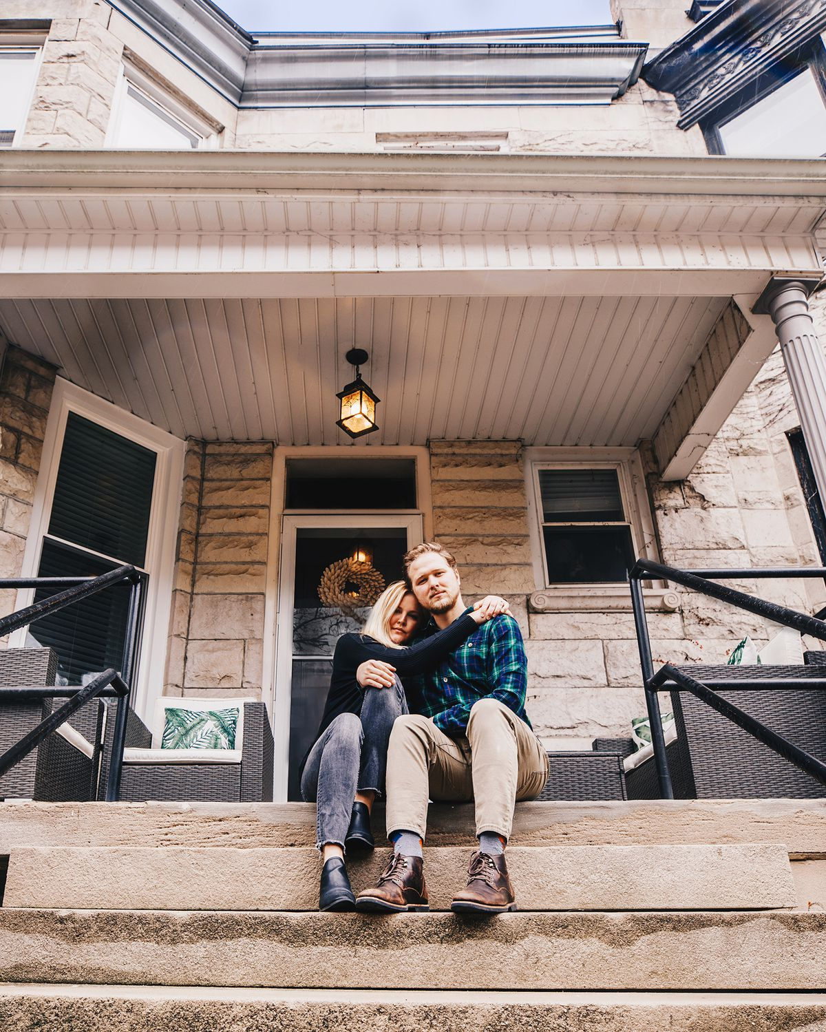 Angela Conners Treimer poses with her husband, Ben, on their front steps.