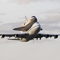 Space shuttle Discovery atop a 747 carrier jet departs the Kennedy Space Center,  Tuesday, April 17, 2012, in Cape Canaveral, Fla. Discovery is being transported to the Smithsonian National Air and Space Museum in Washington.