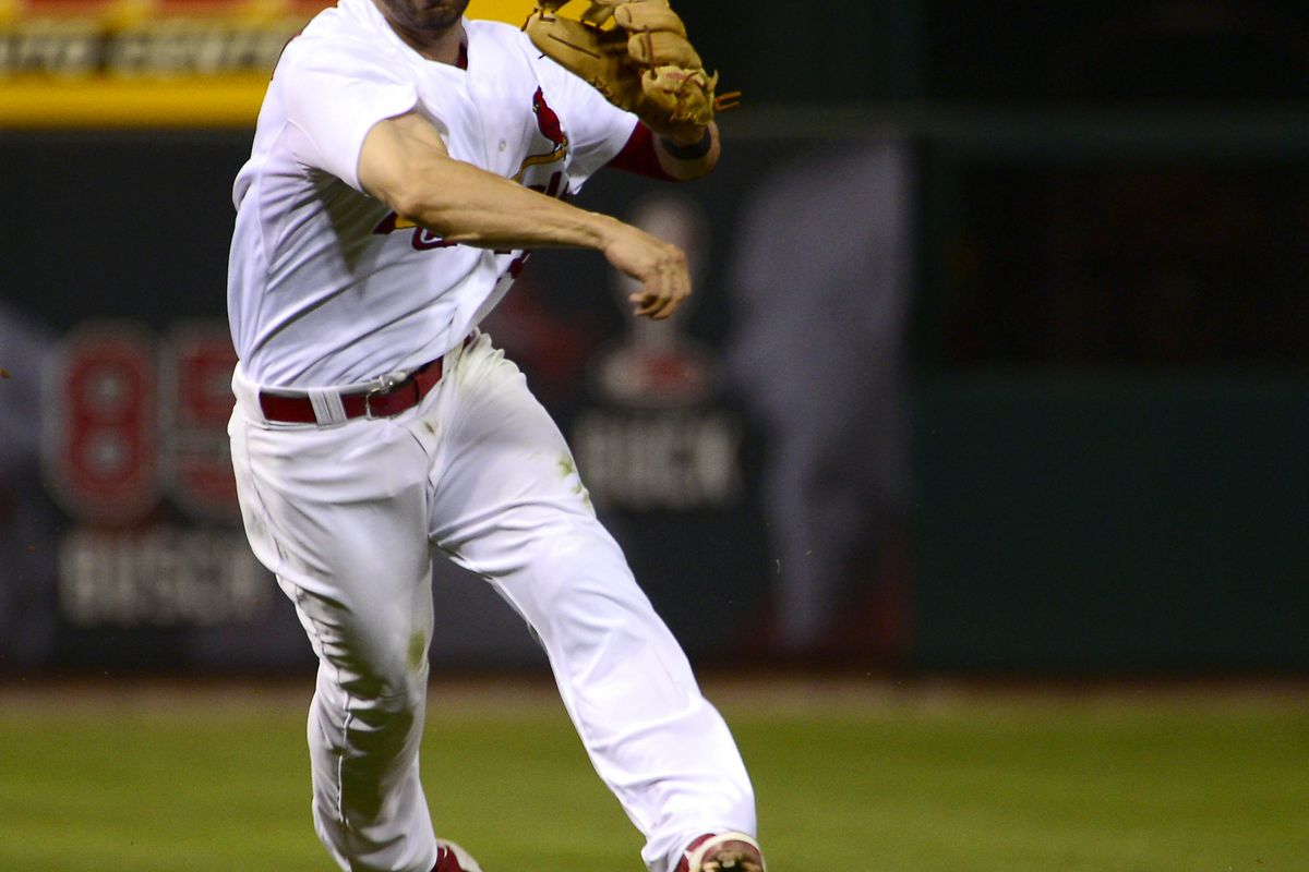Aug 8, 2012; St. Louis, MO, USA; St. Louis Cardinals second baseman Daniel Descalso (33) throws out a San Francisco Giants base runner during the fifth inning at Busch Stadium. Mandatory Credit: Scott Rovak-US PRESSWIRE