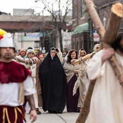Jesus, portrayed by Anthony Macias, carries a cross during Pilsen Via Crucis. | Erin Brown/Sun-Times