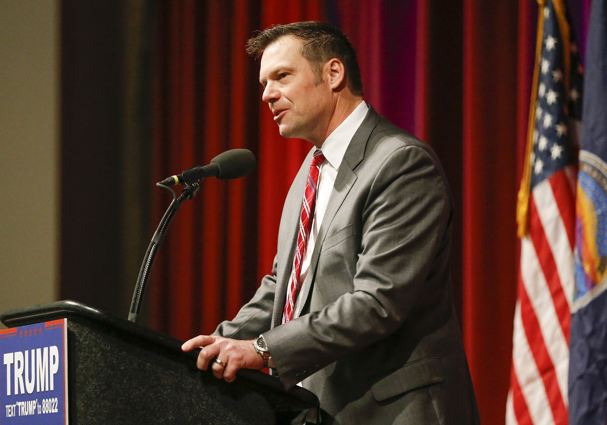 Kris Kobach speaks at a Trump campaign rally.