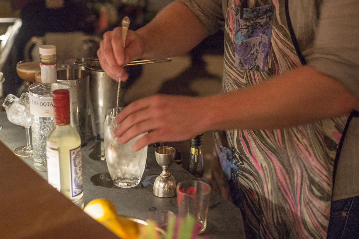 Owner/bartender Nathaniel Meiklejohn mixes a drink at The Bearded Lady's Jewel Box.