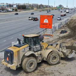 Construction crews work on a new I-15 northbound travel lane, which runs from Bangerter Highway to 9400 South, in Draper on Thursday, April 9, 2020.