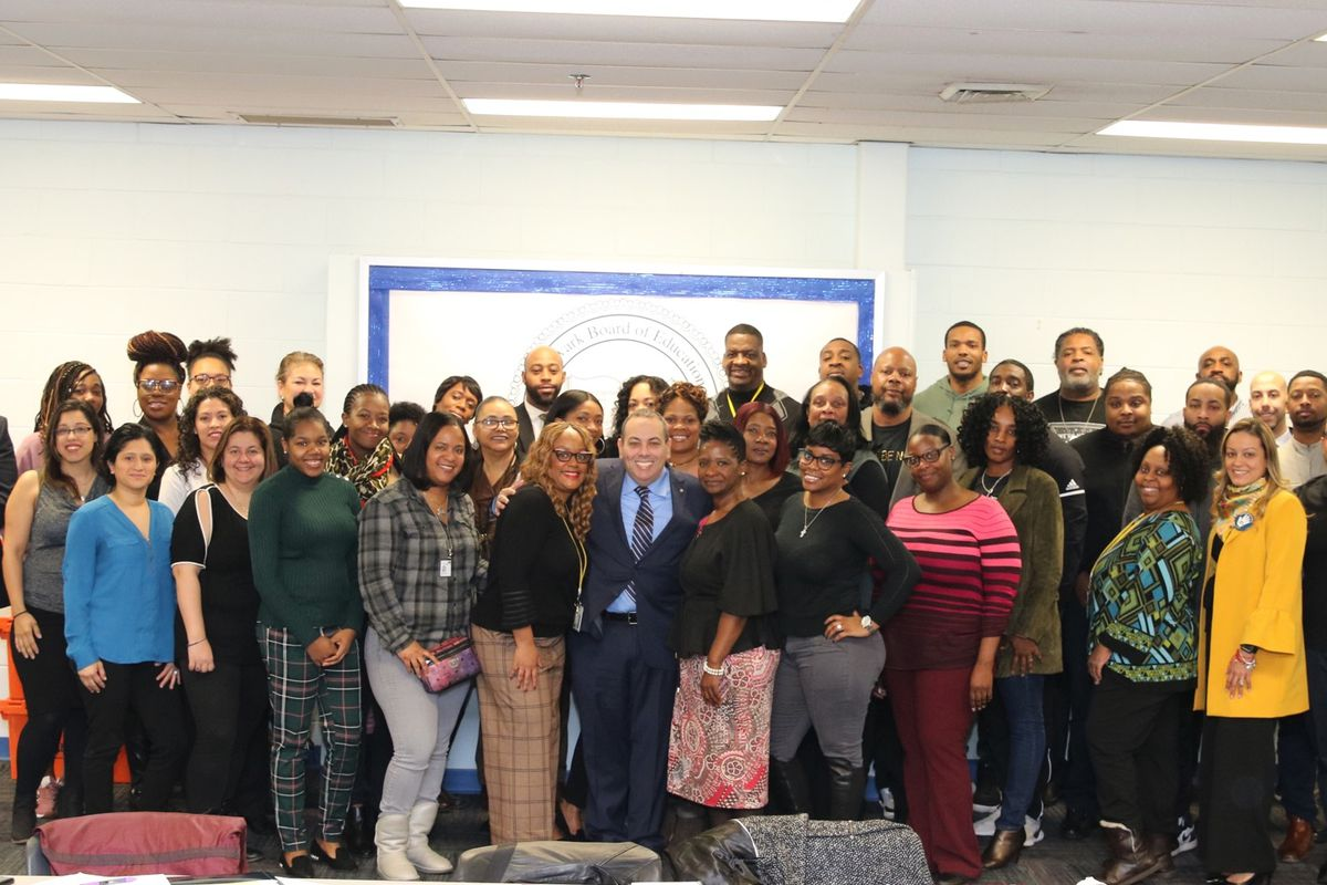 Superintendent Roger León (center) with more than 40 new attendance counselors the district has hired.