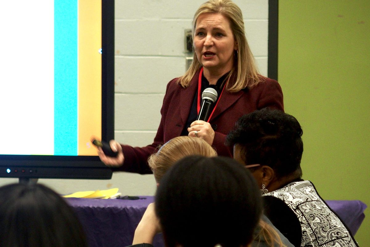Eve Carney, the chief districts and schools officer for the Tennessee Department of Education, speaks at a community meeting in Memphis.