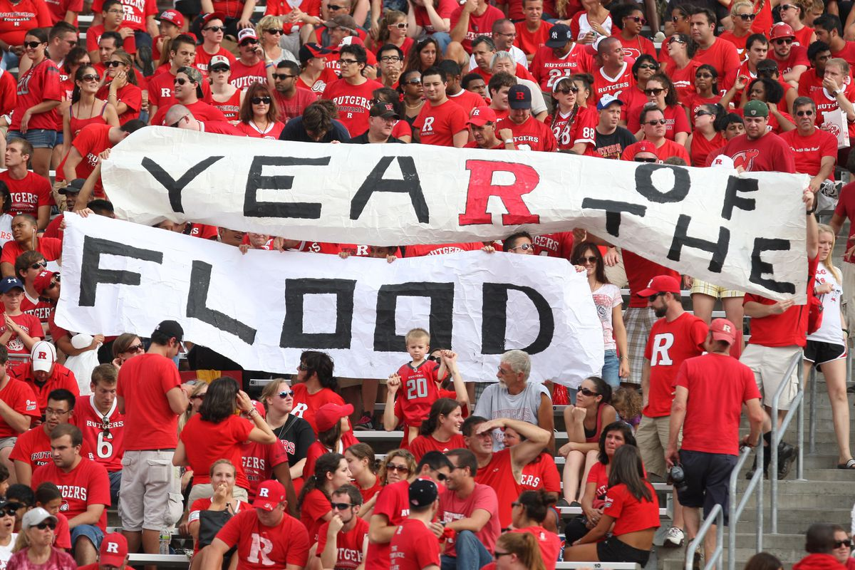Sept 8, 2012; Piscataway, NJ, USA; Fans of the Rutgers Scarlet Knights hold up a sign supporting rookie head coach Kyle Flood during the first half at High Point Solutions Stadium. Ed Mulholland-US PRESSWIRE