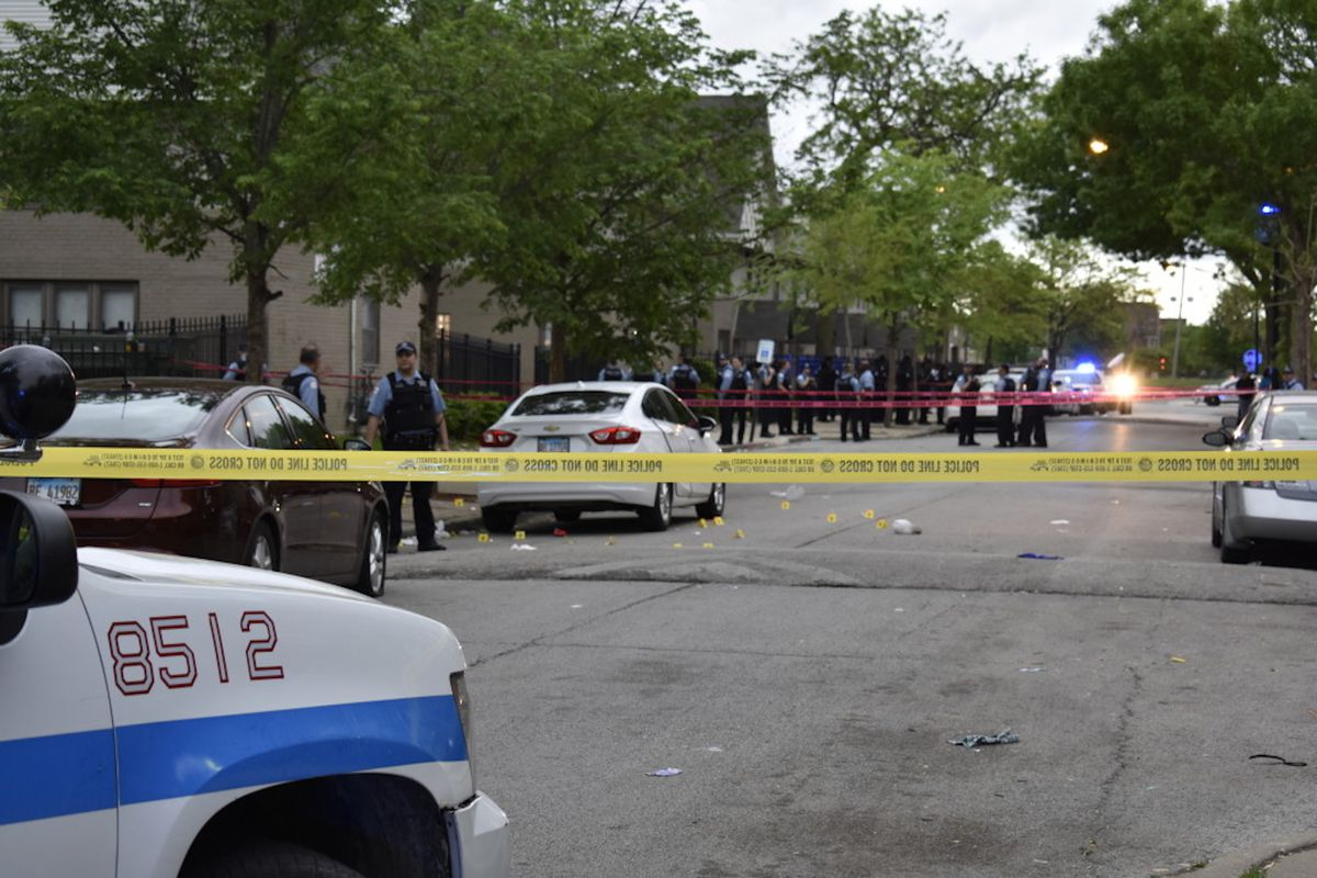 Police cars, yellow tape and officers at the scene of a shooting Sunday morning in the 1300 block of West Hastings.