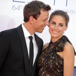 Actor Seth Meyers, left and wife Alexi Ashe arrive at the 64th Primetime Emmy Awards at the Nokia Theatre on Sunday, Sept. 23, 2012, in Los Angeles.