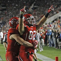 Utah Utes tight end Jake Murphy (82) celebrates a touchdown as the University of Utah and Brigham Young University play football Saturday, Sept. 17, 2011, in Provo, Utah.