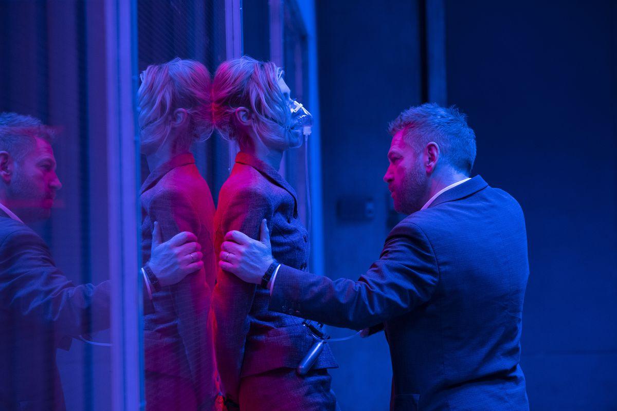 ELIZABETH DEBICKI and KENNETH BRANAGH in Warner Bros. Pictures' action epic TENET