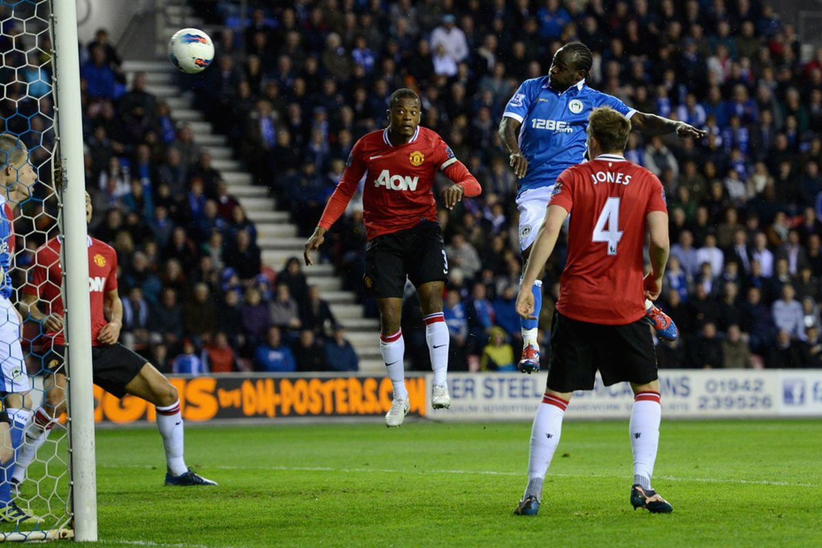 Victor Moses of Wigan scores a goal which was disallowed during the Barclays Premier League match between Wigan Athletic and Manchester United at DW Stadium.