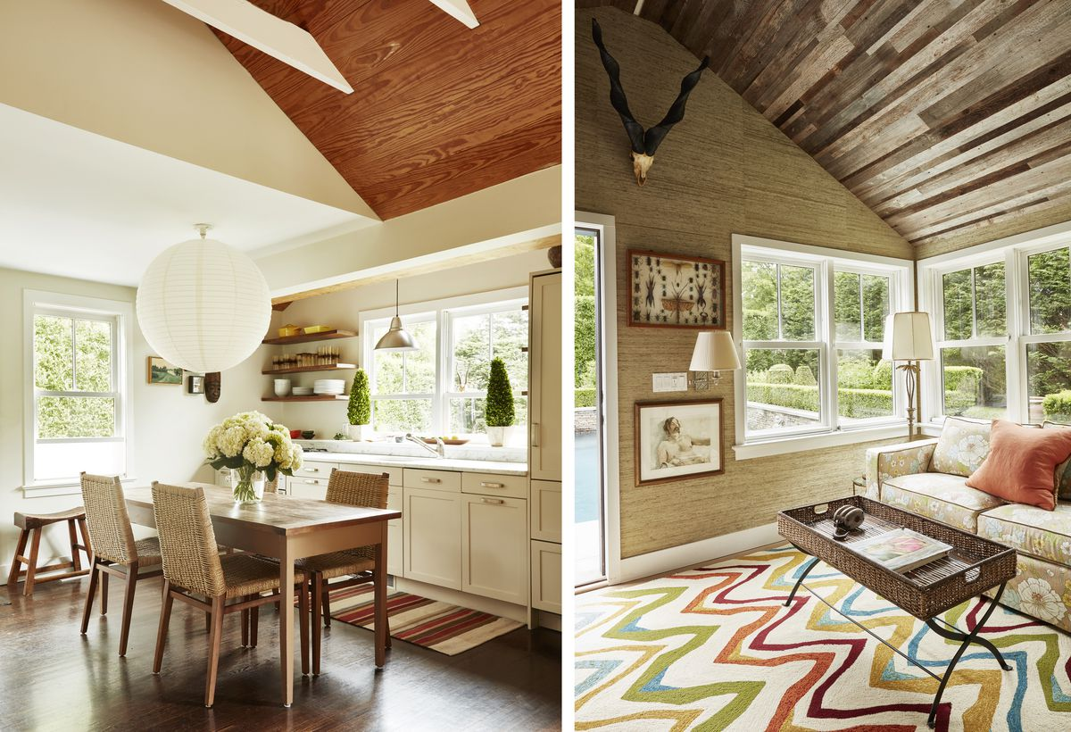 The kitchen is small and white. A dining room table is adjacent to it. The pool house has rustic, reclaimed wood on the ceiling, tan grasscloth wallpaper on the wall, and a colorful chevron-patterned rug on the floor.