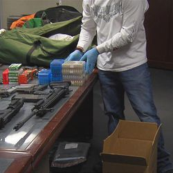 Drugs, weapons and other evidence seized over the weekend by Drug Enforcement Administration agents in Utah, Sunday Feb. 12, 2012.