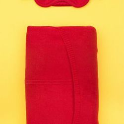 """Phillip Lim x Opening Ceremony red blanket with eye mask, $100 at <a href=""""http://www.openingceremony.us/products.asp?menuid=2&catid=1012&designerid=1443&productid=11374 """"target=""""_blank"""">Opening Ceremony</a>"""
