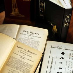 Historic title pages of the Book of Mormon in Spanish, Japanese, Mandarin, Portuguese, and German.