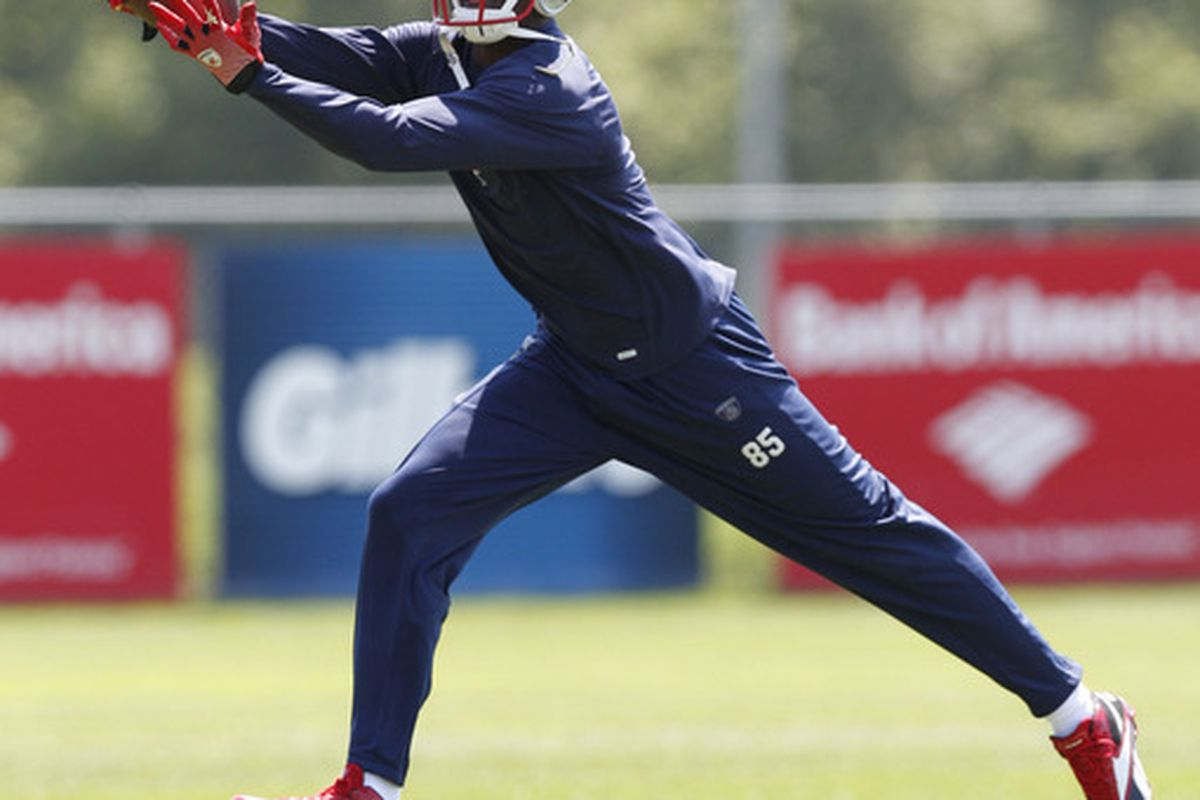 May 31, 2012; Foxboro, Massachusetts, USA; New England Patriots wide receiver Chad Ochocinco (85) during OTA on the practice field at Gillette Stadium.  Mandatory Credit: Greg M. Cooper-US PRESSWIRE
