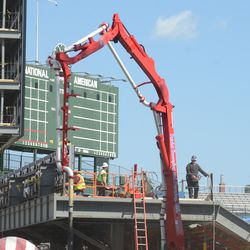 2:54 p.m. Concrete being poured in the left-field corner -