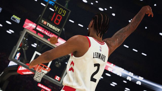 screenshot of Kawhi Leonard of the Toronto Raptors with his back to the camera watching his shot go in