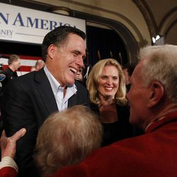 FILE - In this Dec. 27, 2011 file photo, Republican presidential candidate, former Massachusetts Gov. Mitt Romney, left, and his wife Ann greet supporters after a campaign stop in Davenport, Iowa. President Barack Obama gets mediocre marks for his handling of the economy, and Mitt Romney easily outpolls his Republican rivals in an Associated Press survey of economists. (AP Photo/Chris Carlson, File)