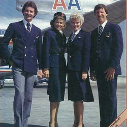 """An advertisement showing off the men's and women's uniforms in the 80s. Photo via <a href-""""http://airlinespastpresent.blogspot.com/search/label/American%20Airlines"""">Airlines Past & Present.</a>"""