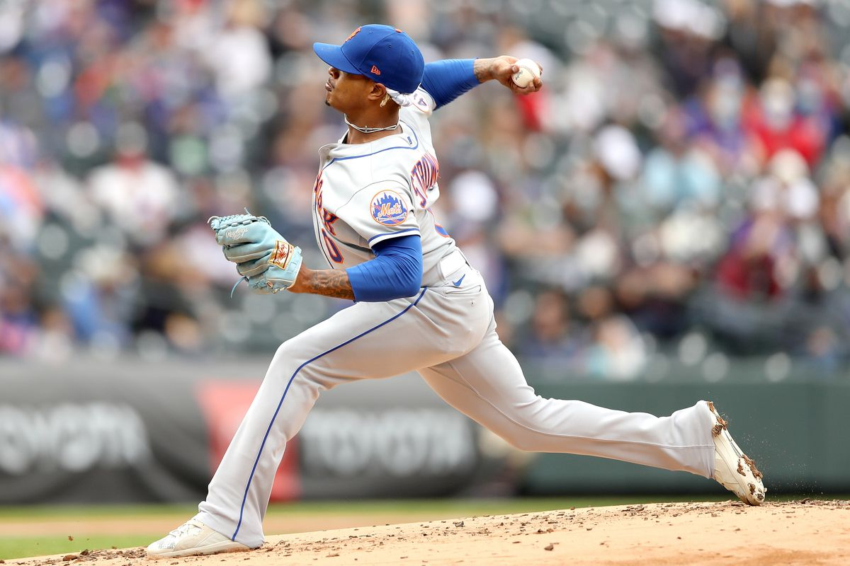 Starting pitcher Marcus Stroman #0 of the New York Mets throws against the Colorado Rockies during the second inning at Coors Field on April 18, 2021 in Denver, Colorado.