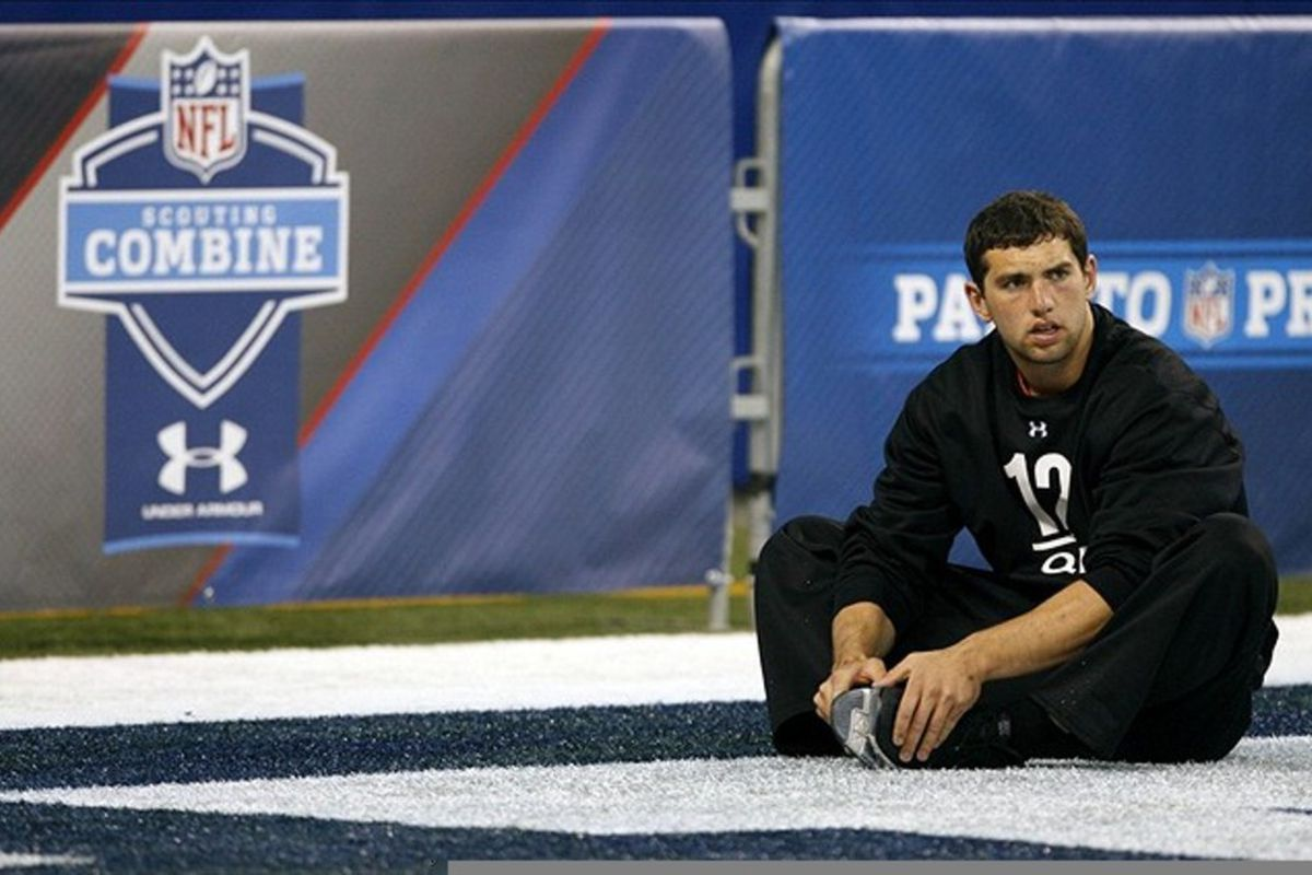 Feb 26, 2012; Indianapolis, IN, USA; Stanford Cardinal quarterback Andrew Luck stretches during the NFL Combine at Lucas Oil Stadium. Mandatory Credit: Brian Spurlock-US PRESSWIRE