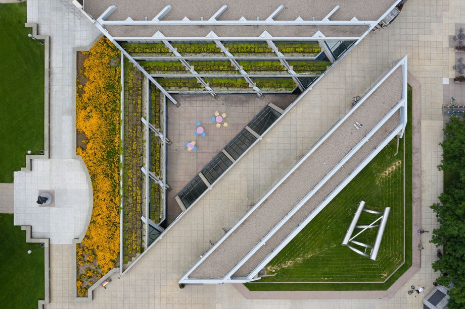 A striking modern building courtyard shot from above with planted walls and walkways.