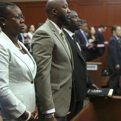 Trayvon Martin's parents Sabrina Fulton, second from left and Tracy Martin stand in court as the jury leaves the courtroom to deliberate during George Zimmerman's trial in Seminole circuit court in Sanford, Fla. Friday, July 12, 2013. Zimmerman has been charged with second-degree murder for the 2012 shooting death of Trayvon Martin. (AP Photo/Orlando Sentinel, Gary W. Green, Pool)