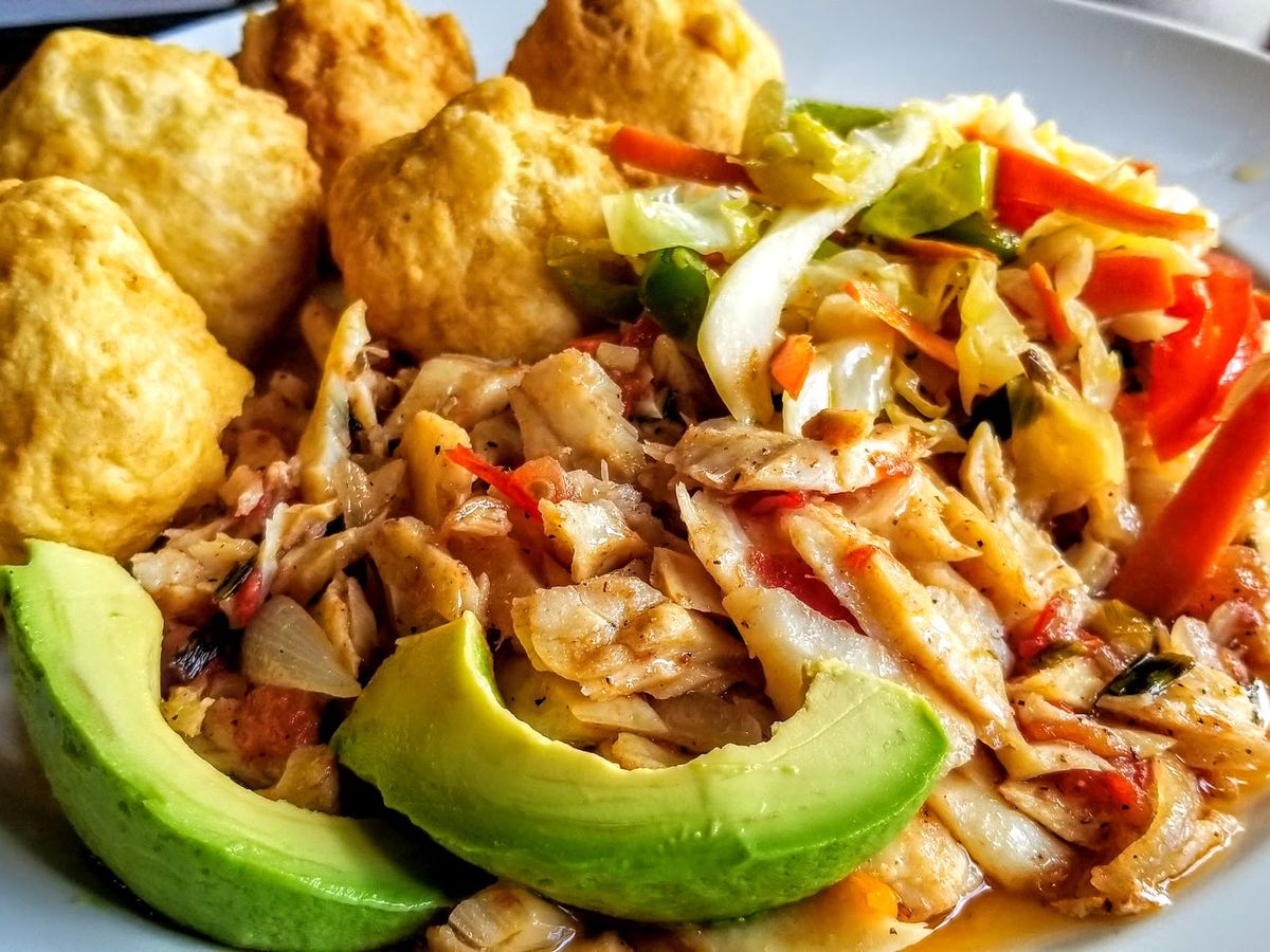 ackee & saltfish served on a plate alongside avocado and fried dumplings at Yaad Style Jamaican Cuisine