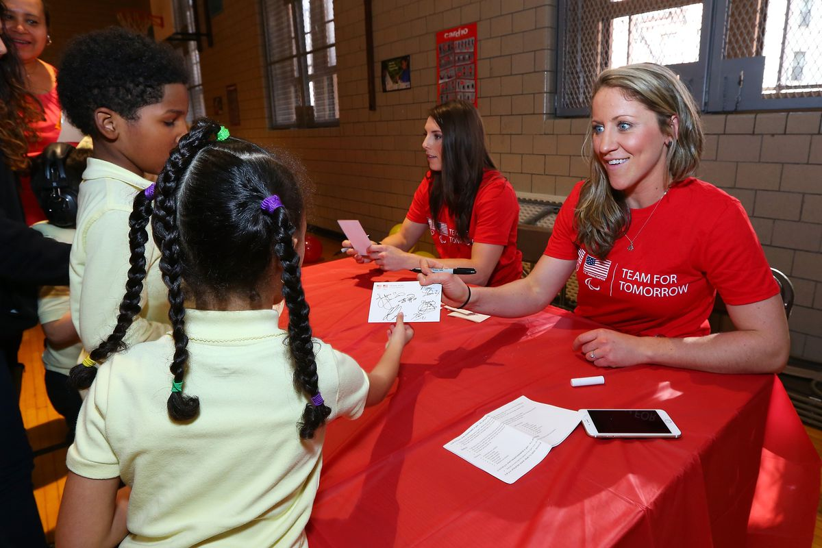 USWNT players Hilary Knight and captain Meghan Duggan sign autographs for children at a USOC event marking one year to Pyeongchang