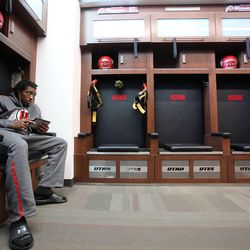 Andre Lewis hangs out in the locker room of the new Spence and Cleone Eccles Football Center at the University of Utah in Salt Lake City on Thursday, Aug. 15, 2013.