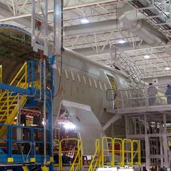 Workers assemble the middle section of Boeing's new 787 aircraft at the company's plant in North Charleston, S.C., on Friday, April 27, 2012. The company was rolling out the first of its new 787s manufactured at its South Carolina plant which opened last year.