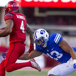 Brigham Young Cougars linebacker Francis Bernard (13) attempts to bring down Utah Utes running back Troy McCormick (4) during an NCAA football game in Salt Lake City on Saturday, Sept. 10, 2016. Utah leads rival BYU 14-13 at halftime.