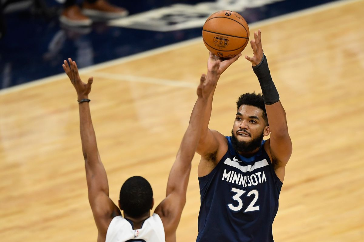 Karl-Anthony Towns of the Minnesota Timberwolves shoots the ball against the Memphis Grizzlies during the second quarter of the game at Target Center on January 13, 2021 in Minneapolis, Minnesota.
