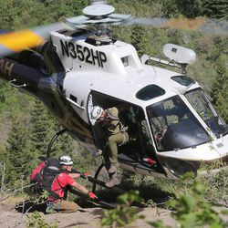 A Utah Department of Public Safety helicopter drops off members of the Salt Lake County Search and Rescue team in an effort to recover the body of a 22-year-old hiker who fell in Bell Canyon on Monday, June 5, 2017. Siaosi Brown's body was spotted in the lower falls of the canyon. His body was trapped on some logs in the middle of the waterfall, Unified Police Lt. Brian Lohrke said.
