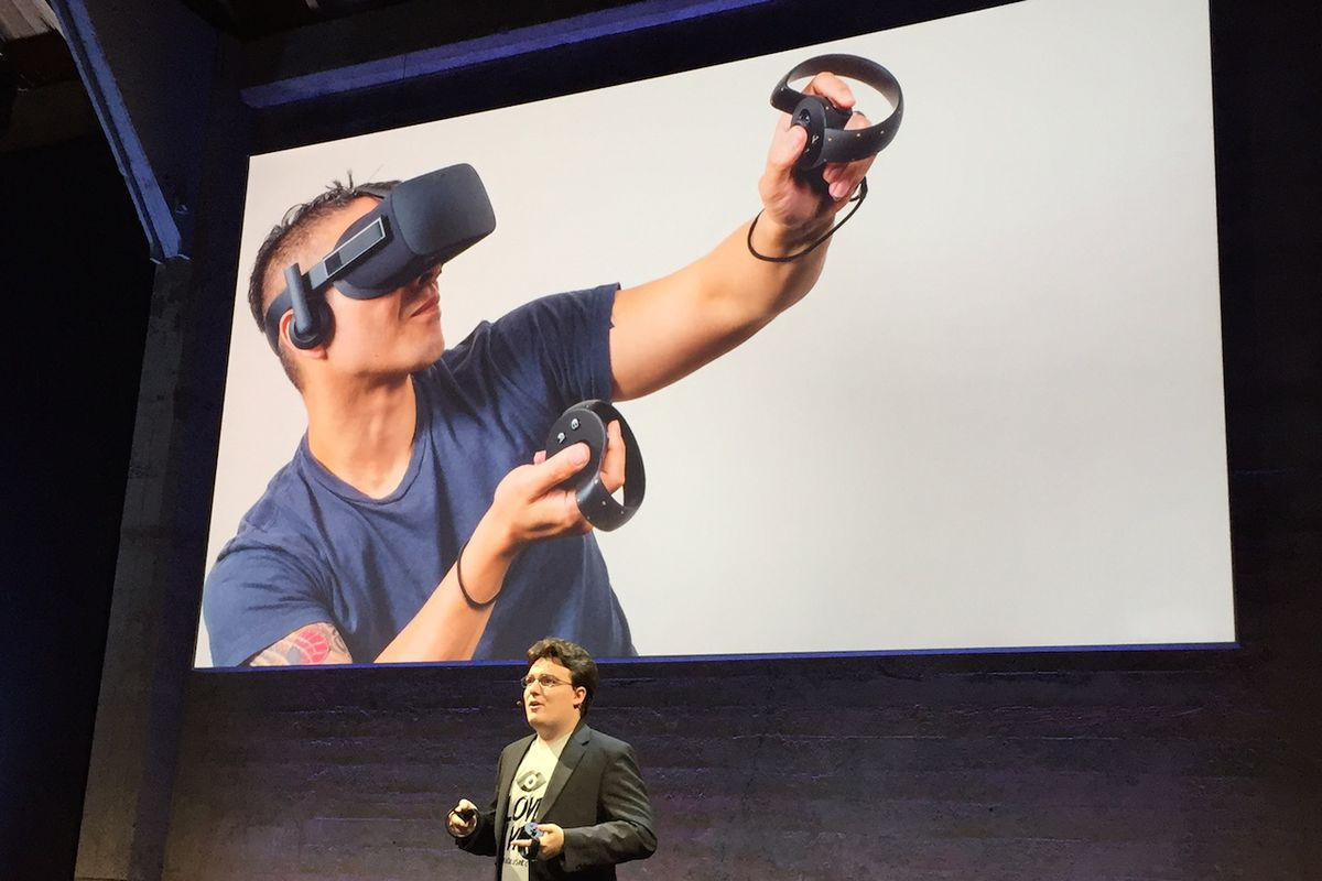 Oculus VR co-founder Palmer Luckey shows off Oculus Touch at a press event in June.