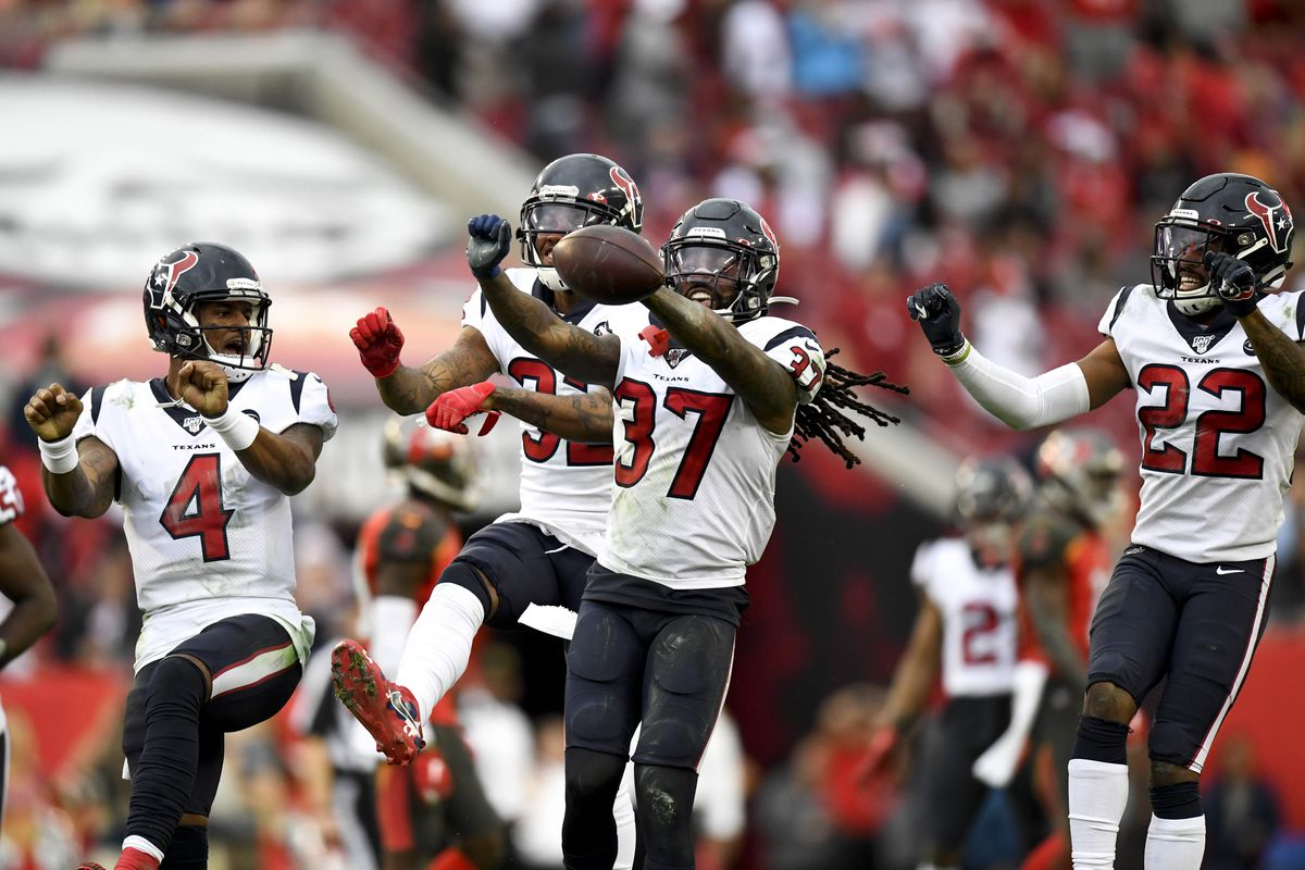 Houston Texans strong safety Jahleel Addae celebrates with his teammates cornerback Gareon Conley and quarterback Deshaun Watson during the fourth quarter against the Tampa Bay Buccaneers at Raymond James Stadium.
