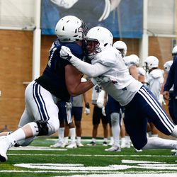 BYU offensive lineman Austin Hoyt, left, participates in a drill during the Cougars' practice in the Indoor Practice Facility on Thursday, March 15, 2018 in Provo.