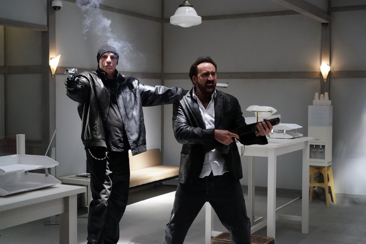 nic cage and nick cassavettes shooting up a bank in Prisoners of the Ghostland
