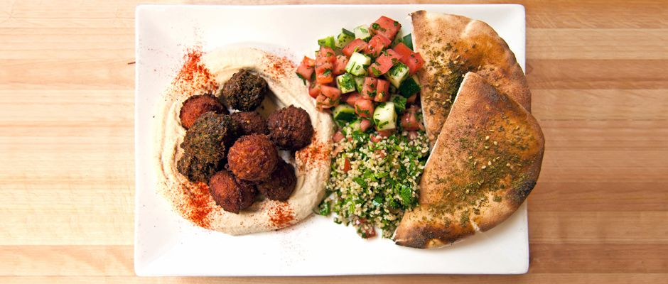 Falafel platter with hummus, Israeli salad, tabbouleh, and pita