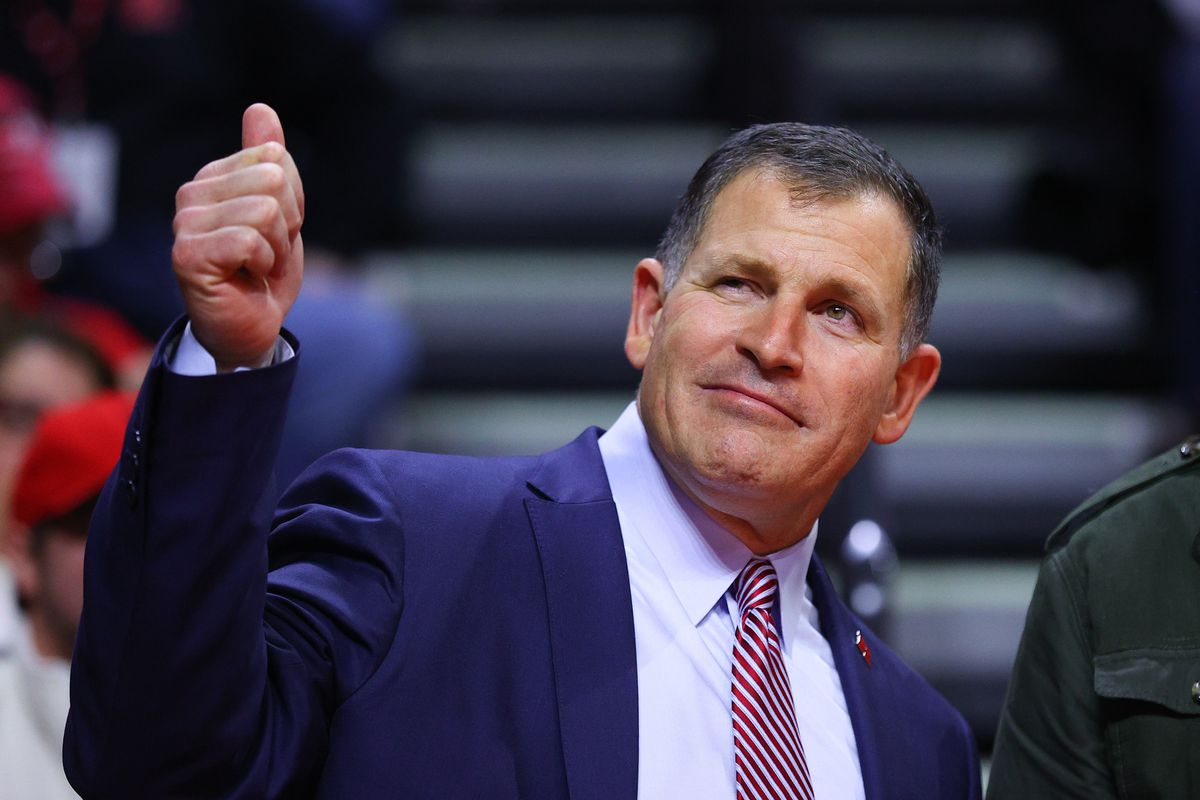 Rutgers Scarlet Knights head football coach Greg Schiano gives a wink and a thumbs up to the student section during the second half of the college basketball game between the Rutgers Scarlet Knights and the Maryland Terrapins on March 3, 2020 at the Louis Brown Athletic Center in Piscataway, NJ.