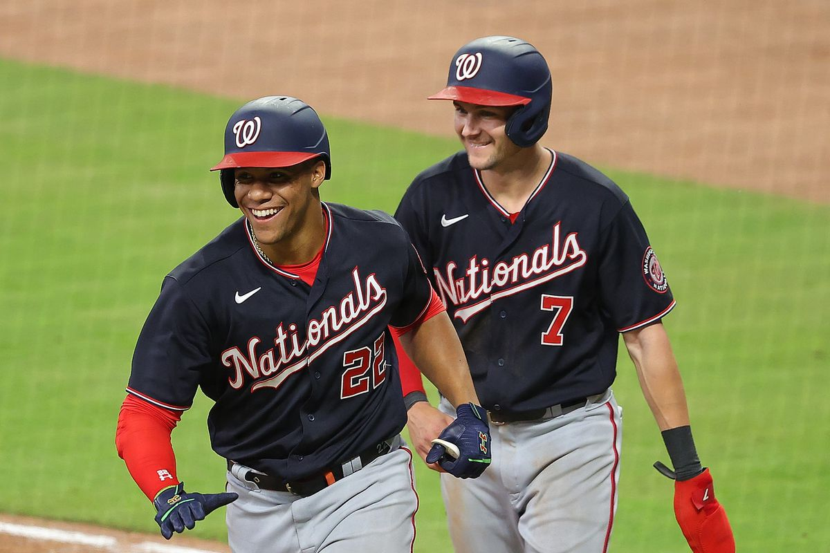 Juan Soto #22 of the Washington Nationals reacts with Trea Turner #7 after hitting a two-run homer in the eighth inning against the Atlanta Braves at Truist Park on June 01, 2021 in Atlanta, Georgia.
