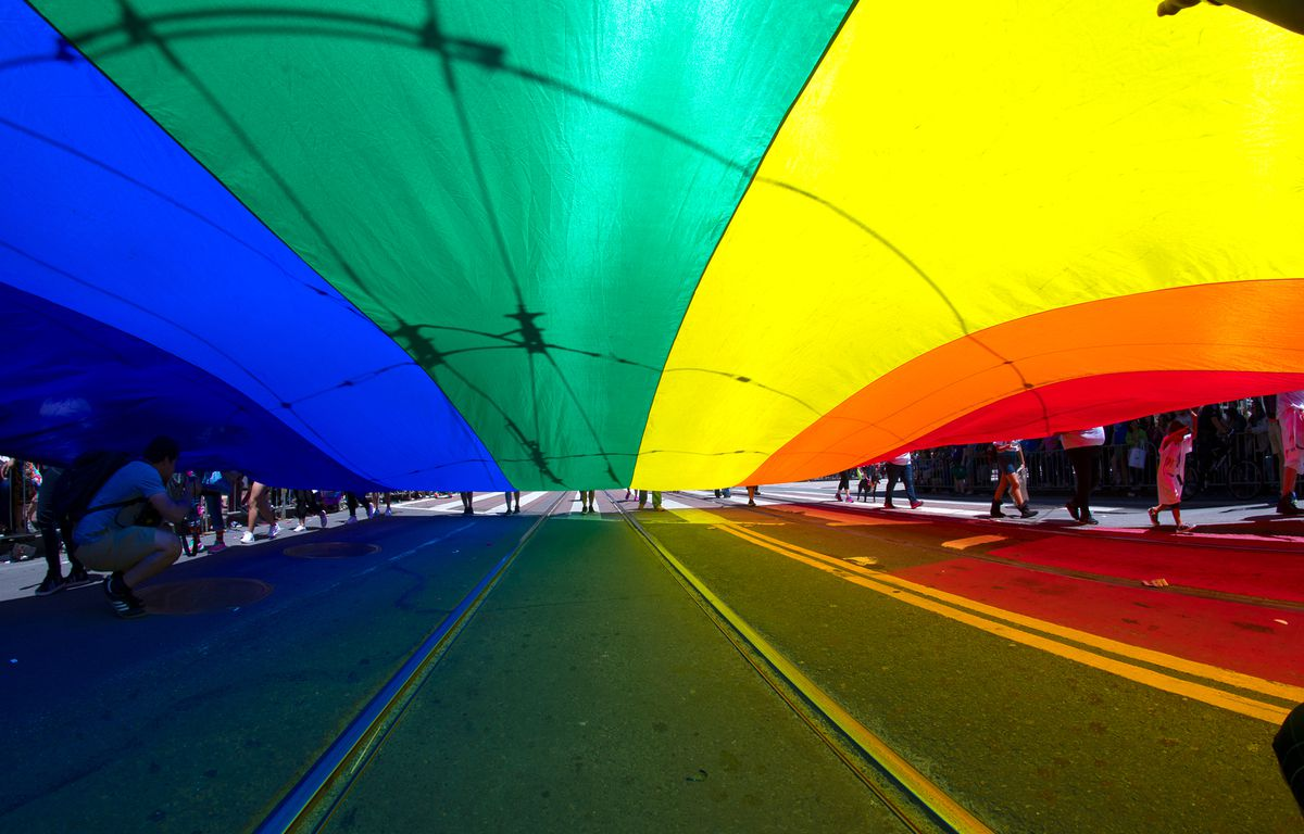 Underneath the massive rainbow flag on Market Street during the 2016 Pride parade.