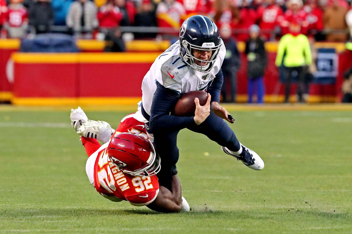 Tennessee Titans quarterback Ryan Tannehill is tackled by Kansas City Chiefs defensive end Tanoh Kpassagnon during the second half in the AFC Championship Game at Arrowhead Stadium