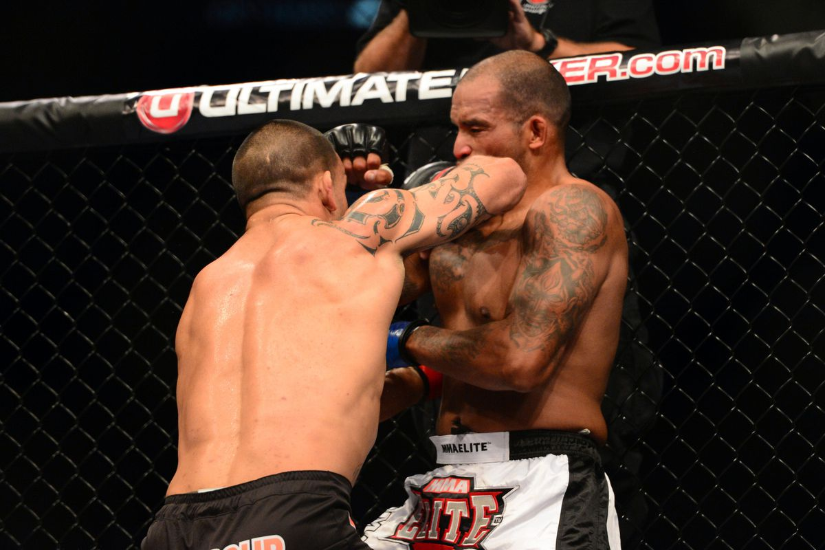 James Te Huna (left) fights Joey Beltran (right) in just the 10th light heavyweight bout in the UFC this year. Mandatory Credit: Kyle Terada-US PRESSWIRE