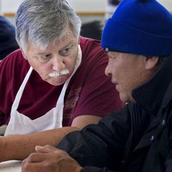 Ed Snoddy speaks with Tyler Charlie Brown during the Thanksgiving meal at Grace Mary Manor in South Salt Lake on Tuesday, Nov. 22, 2016. Snoddy cooked 110 turkey breasts and side dishes for the residents.
