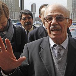Syrian opposition member Hassan Abdul-Azim speaks to press as he walks out of the building of the Russian Foreign Ministry in Moscow, Russia, Monday, April 16, 2012 after talks.